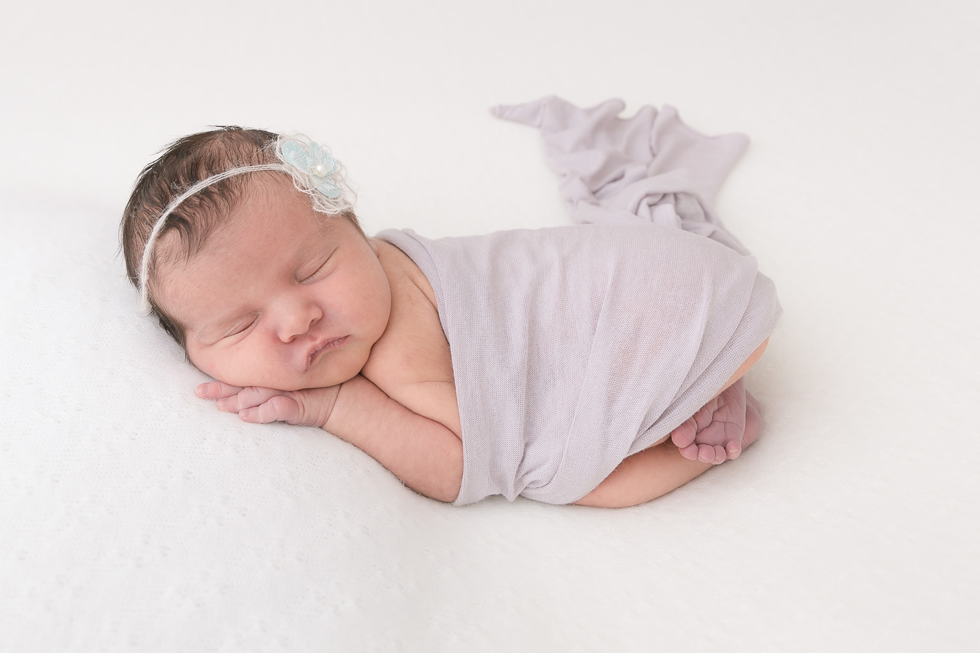 Newborn photographer a sleeping baby