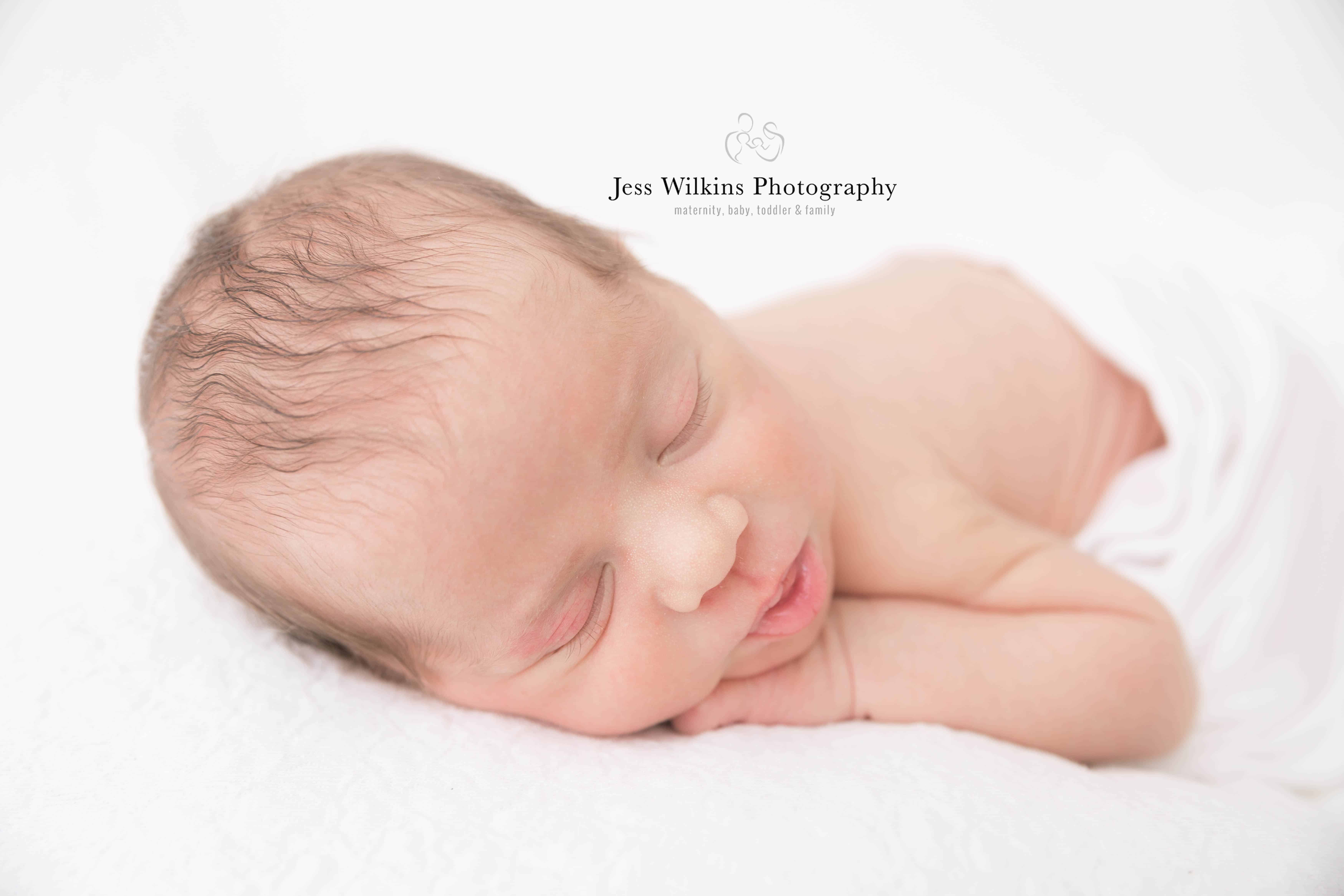 newborn photographer a sleeping baby