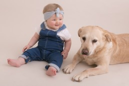 photo of dog and baby
