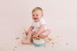 child smiling at cake